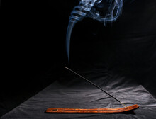 Indian Incense Stick With Smoke On Black Background
