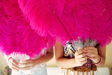 Two Girls Holding Feather Fans
