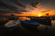 Port Of The Village Of Taranto Vecchia At Dawn With Fishing Boats In The Foreground