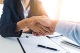 two business person shaking hands after deal contract done.