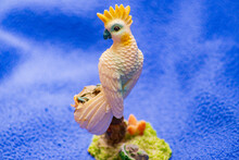 Toy Green White Parrot On A Palm Tree
