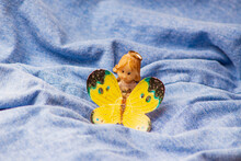 Toy Angel With A Yellow Butterfly