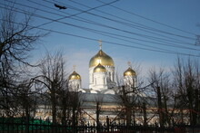 Photo Of The Russian Orthodox Church. White Church With Golden Domes Against A Bright Blue Sky Background. Conveys A Mood Of Calm And Relaxation.