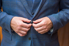 A Man Fastens A Button In A Stylish Suit