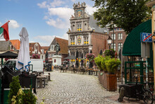 Roode Steen Square With Ancient Town Hall And Statue Of Jan Pieterszoon Coen.