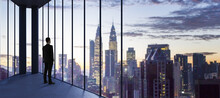 Businessperson In Empty Office Looking Out Of Panoramic Window With Bright City Downtown And Sky View With Mock Up Place. Future, Tomorrow, Perspective And Career Concept.