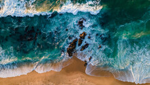Turquoise Water With Wave With Sand Beach Background Rocks And Corals From Aerial Top View In Sunset. Concept Summer