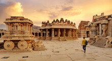 Ancient Stone Chariot With Archaeological Ruins In The Courtyard Of Vittala Temple At Hampi, Karnataka India At Sunset