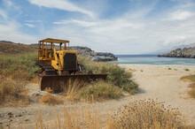 Abandoned Bulldozer On The Beach