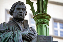 The Memorial For The Reformer Martin Luther On The Market Square In Lutherstadt Wittenberg (Saxony-Anhalt, Germany) Commemorates The Reformation. Bronze Figure By Johann Gottfried Schadow (1821).