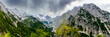 canvas print picture - View to the Impressive gorge, Höllentalklamm, Hell Valley Gorge near Grainau with dramatic rain and cloud sky and sunshine. Höllental, Germany, Europe. Canyon near Zugspitze Mountain in Bavaria