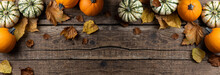 Autumn Composition From Pumpkins And Autumn Leaves On Wooden Background. Concept Of Thanksgiving Day Or Halloween. Autumn Background With Copy Space