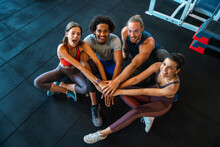 Picture Of Cheerful Fitness Team Exercise Together In Gym