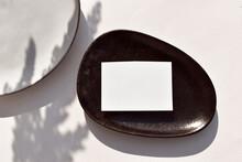 Fall Minimalist Stationery Still Life Scene With Empty Blank Wedding Card, Handmade Ceramic Plate On Neutral Background. Eco Autumn Mockup Flat Lay, Pampas Shadows. Wabi Sabi Style. Copyspace.