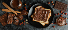 Concept Of Delicious Food With Chocolate Paste On Black Smokey Background