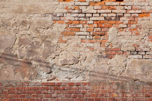 A Fragment Of An Old, Dingy Brick Wall Along With Remnants Of Plaster.