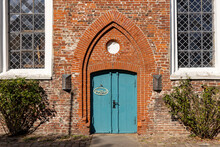 """Ancient Church Door Of The Lutheran St. Laurentius Church  (1200 AD) At Toenning, Germany. The Sign At The Door Reads """"open""""."""