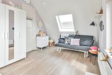 Children Room Interior With Sofa In Attic