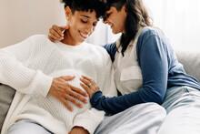 Pregnant Female Couple Bonding At Home