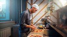 The Chef Is Cooking Pizza. Catering Kitchen Work.