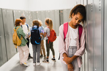 Lonely Sad African-american Schoolgirl Crying While All Her Classmates Ignoring Her. Social Exclusion Problem. Bullying At School Concept. Racism Problem