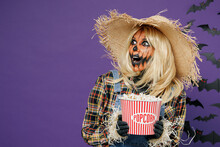Young Shocked Woman With Halloween Makeup Mask In Straw Hat Scarecrow Costume Hold Popcorn Bucket Watch Horror Look Aside Isolated On Plain Dark Purple Background Studio Celebration Holiday Concept.