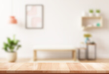 Empty Brown Wooden Table For Product Display Montage With Blur Living Room Interior