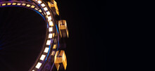 Ferris Wheel Entertainment Object In Amusement Park At Night Long Exposure Circle Motion Festive Lighting On Black Background Empty Copy Space For Your Text Here Of Advertising Panoramic