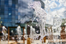 Selective Closeup Of Water Splashes Of A Fountain In A Cit