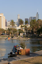 Homeless Encampment Along The Water In MacArthur Park In Los Angeles