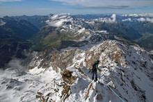 Alpinist On A Difficult Alpine Trail On Rocky Ridge, Quintino Sella, Pennine Alps, Aosta Valley, Italy