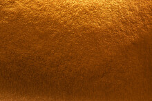 Textured Metallic Gold Background With Light And Dark Highlights, Bright And Shiny Golden Metal Texture