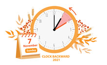 Daylight Saving Time Ends Concept. Vector Illustration Of Clock And Calendar Date Of Changing Time In November 7, 2021 With Autumn Foliage Decoration. Fall Back Time Illustration Isolated On White