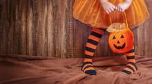 Halloween Sweets Bucket On The Child's Hands