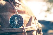 Compass Of Tourists On Backpack At Riverside.