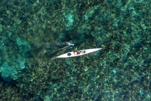 Single Seat Canoe Rowing Over A Shallow Lagoon, Aerial View.