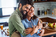Happy couple in love having fun in kitchen at home