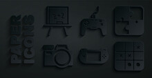 Set Portable Video Game Console, Puzzle Pieces Toy, Photo Camera, Tic Tac Toe, Gamepad And Chalkboard Icon. Vector