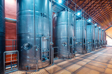Large Metal Vats In Which Wine Or Beer Is Fermented At The Factory At The Winery. Concept Of Technologies And Equipment For The Production Of Alcoholic Beverages
