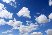 Clouds Scattered Over An Intense Blue Sky