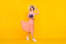 Photo Of Girl Hold Bouquet Flowers Look Empty Space Wear Straw Hat Striped Dress Isolated Yellow Color Background