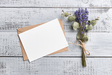 Greeting Or Invitation Card Mockup With Dry Bouquet From Lavender And Eucalyptus On Wooden Background