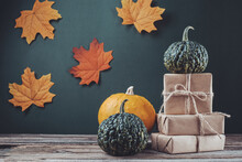 Halloween And Zero Waste, Eco Friendly Packaging. Wrapped Gifts In Craft Paper On A Wooden Table. Ecological Thanksgiving Day Concept, Eco Decor