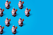 Christmas Pattern Of Santa Claus On Blue Background With Copy Space. Minimal Pattern.
