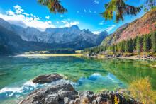 Fairytale  View Of Fusine Lake With Mangart Peak On Background