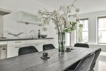 Interior Of Modern Kitchen With Dining Zone In Apartment
