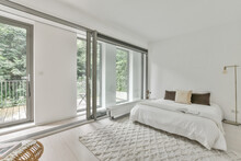 Light Bedroom With Large Windows
