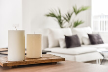 Wax Candles On Wooden Stand In Living Room