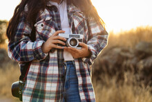Anonymous Photographer With Retro Photo Camera On Walkway In Countryside