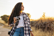 Photographer With Retro Photo Camera On Walkway In Countryside